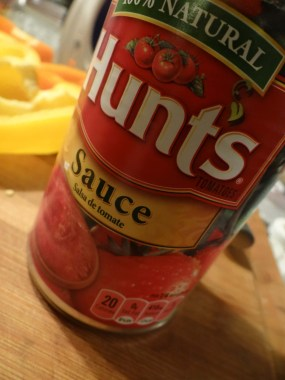 Use one large can of plain tomato sauce. reserving about 1/3 of it for topping the peppers before they go into the oven.