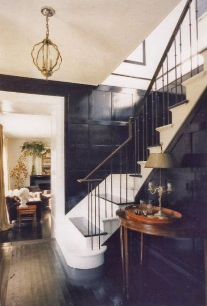Black paneling via greige design