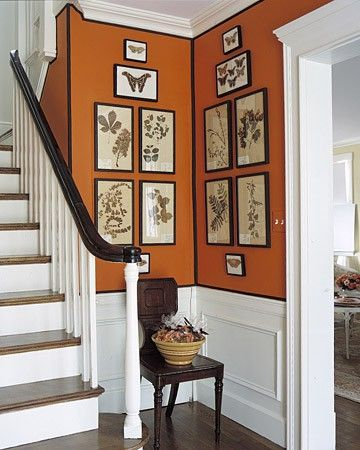 Orange walls and stairs via laura casey interiors