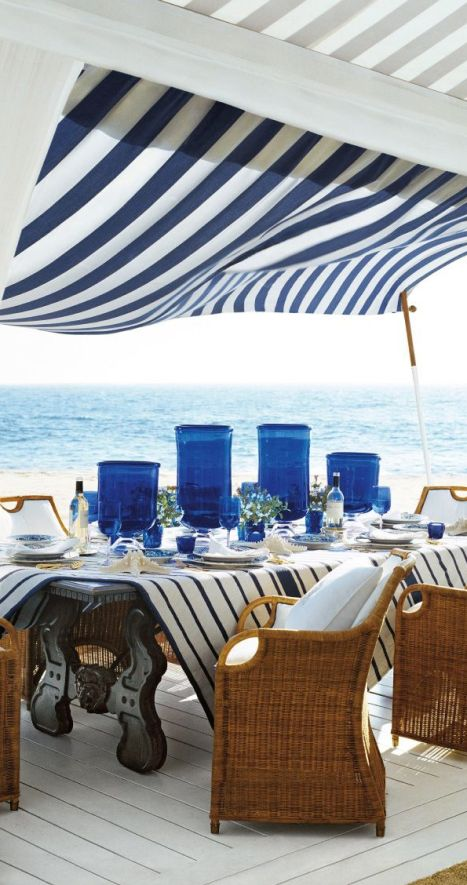 Beach side patio with striped awning