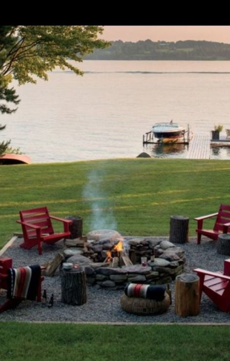 beautiful lake backyard with red chairs