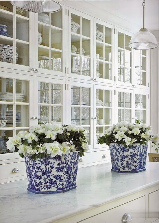white kitchen with blue and white vases
