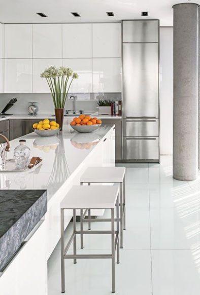 A white  modern kitchen via Tony Ingaro and Randy Kemper via AD