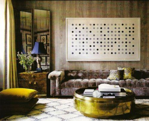 Gray velvet tufted sofa via Elle Decor