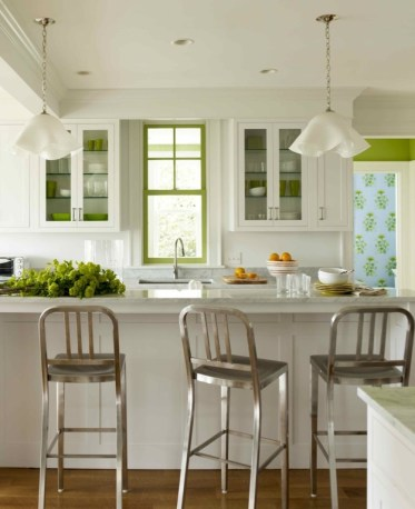 Green painted window frame in this kitchen ny Katie Ridder via her book Rooms