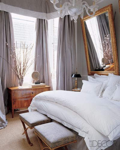 Mirror on the wall of this bedroom in Elle Decor