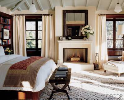A fireplace in the bedroom of Cindy Crawfor designed by Michael S Smith via Elle Decor