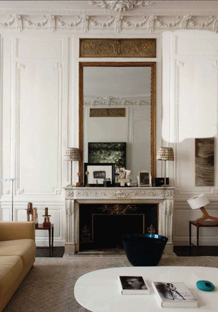 A stunning fireplace in a room designed by Jacques Grange via the White Dresser