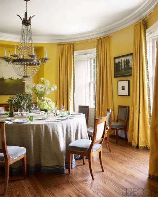A yellow and circular dining room in Nashville by Brookschmidy and Coleman in Elle Decor