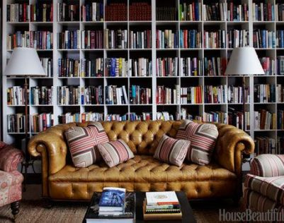 A yummy and comfy tufted library via House Beautiful