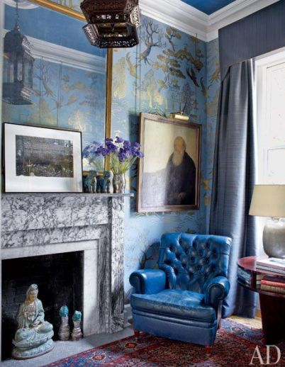 Blue leather tufted chair in the historic Manhattan home of Robert Duffy
