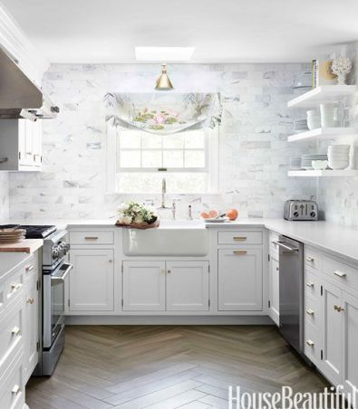 Caitline Wilson created this stunning kitchen with herringbone hardwood via House Beautiful