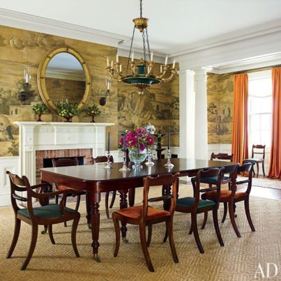 Dining room with a fireplace in a NY home by Gil Schafer