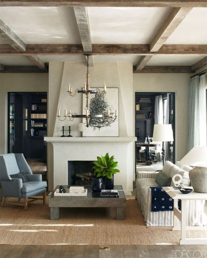Eclectic and Comfy design around this fireplace via Elle Decor