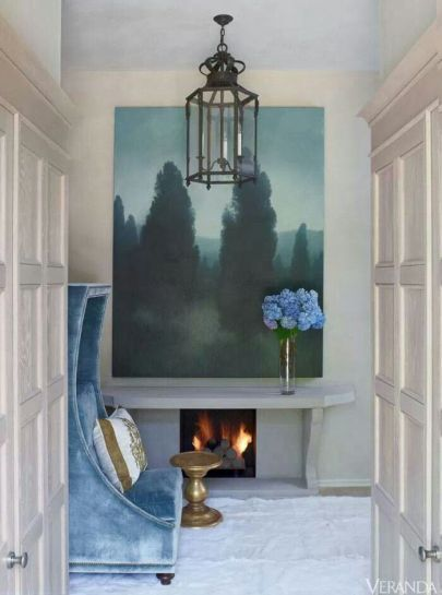 Small fireplace in a nook featured in Veranda