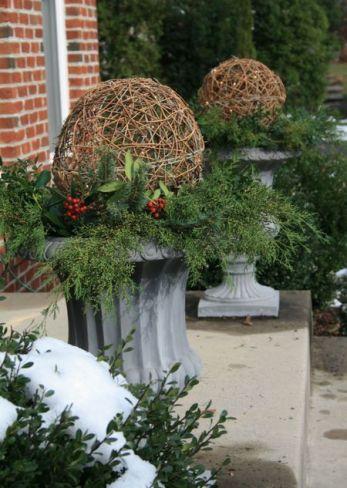 Interesting Christmas porch urns via Digs Digs