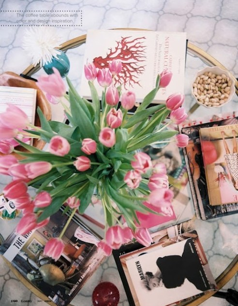 Coffee table of pink tulips via Lonny
