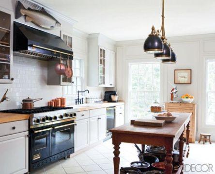 Natural Kitchen witha fish above the stove via Elle Decor