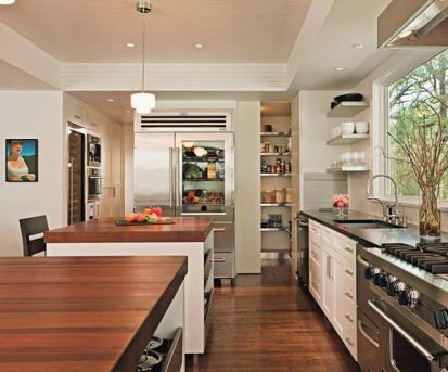 Kitchen with glass door fridge via AD