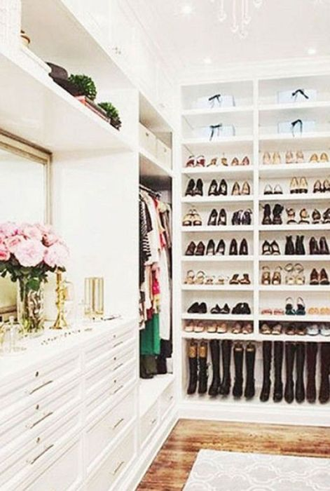 organized walk in closet via elle