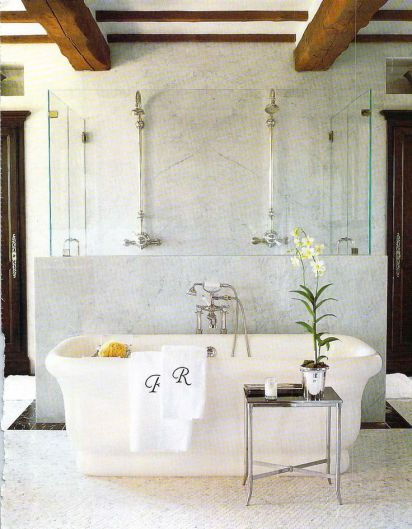 wood beams and a lovely shower and tub combination