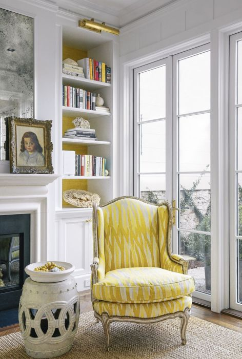 Yellow chair in a corner via Susan Greenleaf via Lonny