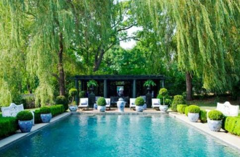 Blue-and-While-Potted-Boxwood-line-to-Pool-via-My-Favorite-and-My-Best
