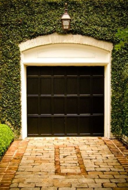Perfect black garage with trimmed ivy  via High Street Market