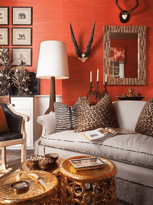 Redish orange wallpaper in a wildly chic setting