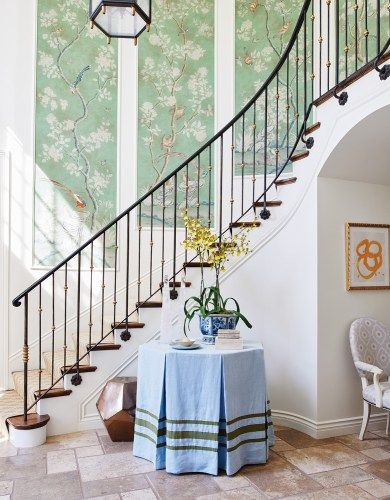 Chinoiserie panels up the staircase by Mark D Sikes