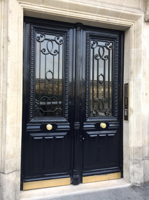 Black Doors in Paris photo by Christina Dandar for The Potted Boxwood