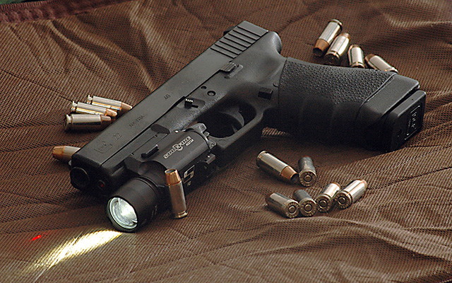Glock 22 - Perfect as your sidearm or nightstand gun.