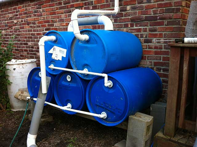 Rain barrels are a simple way to easily collect rainwater. This can be used for gardening or for drinking after purification. Sure beats under the bed.