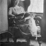"""A woman reads an issue of """"All-Story Weekly"""" sometime between 1915 and 1920."""