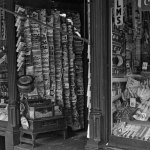 Pulp magazines hang upside down from a rack at a Manchester, N.H., shop in September 1937.