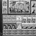 """Posters for """"Love Story Magazine"""" line the bottom of this wall of magazine advertisements in Washington, D.C., in early 1938."""
