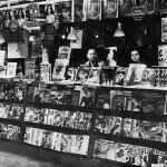 """This photo was taken in late 1939 or early 1940 at the Great Lakes Newsstand at the corner of E 105th Street and Euclid Avenue, Cleveland, Ohio. There are a number of pulps dated early 1940 along the lower portion of the stand. A """"Time"""" magazine has a cover date of Dec. 18, 1939. The quality is poor because it was published as a halftone image in the fanzine """"Xenophile"""" in the 1970s and originally pulled from a news agent publication from 1940."""