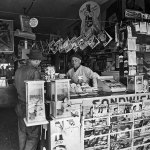 """Look carefully and you'll see a """"Detective Fiction Weekly"""" from March 15, 1941, on display among the magazines at the bottom of this newsstand in Los Angeles. (It's the same newsstand previously shown in December 1939.)"""