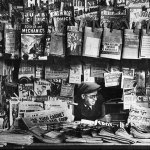 """There are plenty of comics and other magazines, but very few pulps visible on this newsstand. But if you look closely, you'll see the corner of the April 5, 1941, number of """"Detective Fiction Weekly"""" hanging just above the """"Liberty"""" magazine."""