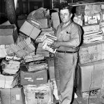 """The caption from this July 1944 photo reads: """"Frank Estis stands in a Chicago street with a small part of his 10 tons of reading matter — 'Pathfinder,' 'Liberty,' 'Saturday Evening Post,' 'True Confessions,' 'Horror Stories,' and other magazines — which were part of movers backache as the 50-year-old World War I veteran was evicted from his home when his lady found his literary collection prevented her keeping fire insurance."""" Only the spines of two pulps are partly visible — """"Complete Western Book Magazine"""" and """"Fifteen Western Stories"""" — but are extremely difficult to see."""