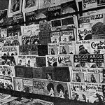 """""""Mr. W.J. Allen's store is a model of neatness and regularity. He never overlooks a chance to add new magazines to his order. He gives all magazines an almost full front cover display,"""" says the caption of this photo from """"The American News Trade Journal"""" (August 1928). You'll find covers from a variety of May 1928 pulps on this display from Hamilton, Ont. (Courtesy of Doug Ellis)"""