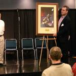 John Goodwin, president of Galaxy Press, donates an autographed lithograph of a Frank Frazetta painting to Pulpcon for auction Saturday night.
