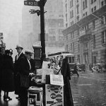 """It's sometime in the 1930s, and this street-side newsstand is touting """"The Shadow"""" magazine with a promotional poster. (From the Dwight Fuhro collection)"""
