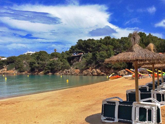 Sun loungers on Arenal Beach, Menorca, Balearic Island, Spain - image zoedawes