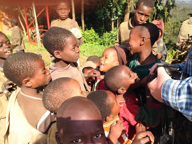 Children admiring a camera in Rwanda - zoedawes