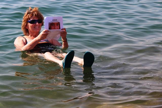 Floating in the Dead Sea Jordan - zoedawes