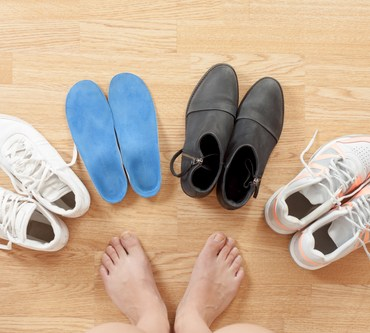 the girl's legs and orthotics