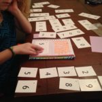 Making 57 using place value cards