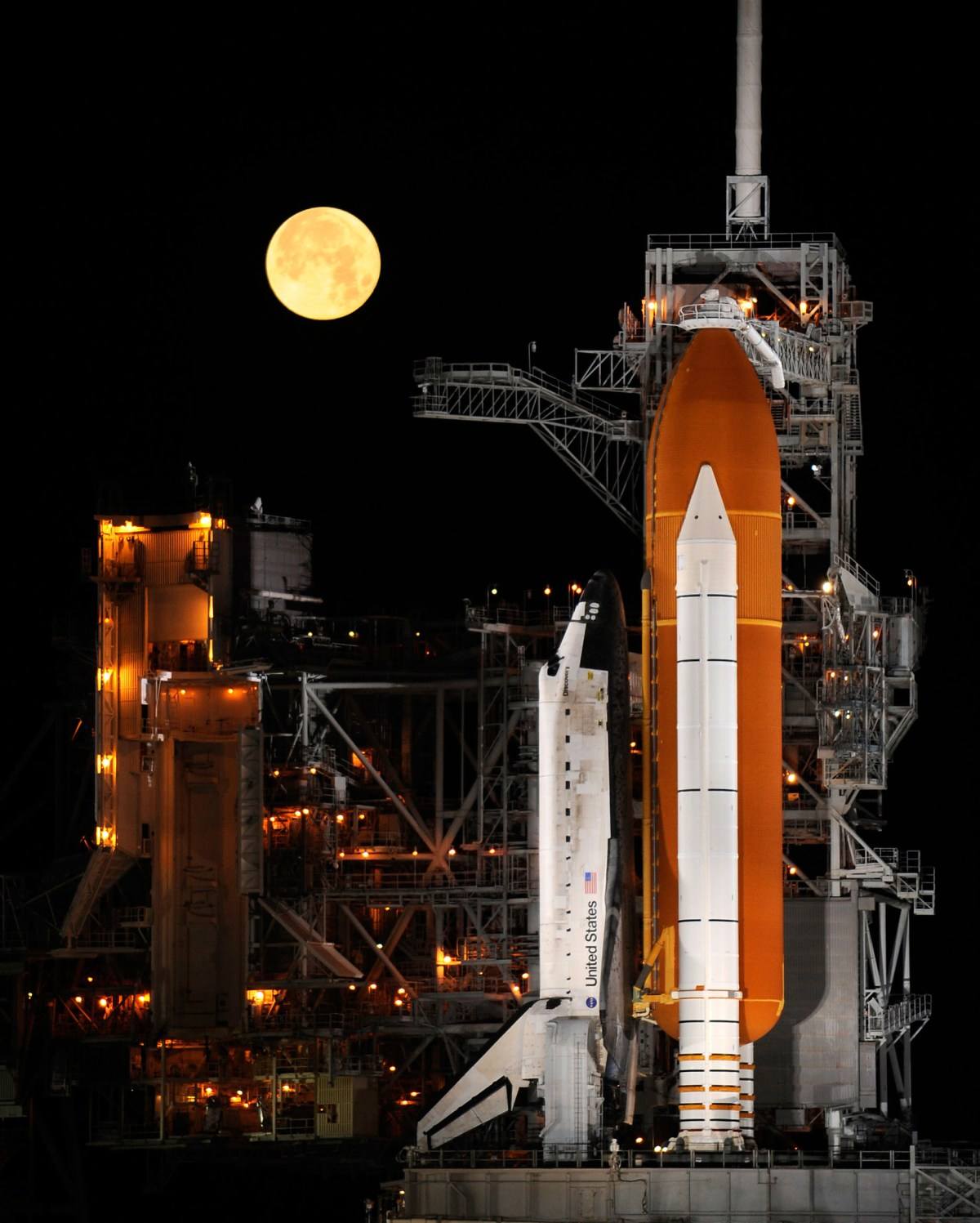 STS-119 Shuttle Discovery With Moon