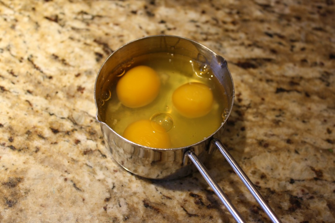 3 eggs cracked in measuring cup